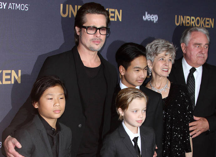 Brad Pitt Brings His Parents, Maddox, Pax & Shiloh To 'Unbroken' Premiere