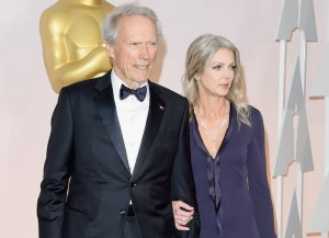 HOLLYWOOD, CA - FEBRUARY 22: Director Clint Eastwood (L) and Christina Sandera attend the 87th Annual Academy Awards at Hollywood & Highland Center on February 22, 2015 in Hollywood, California.