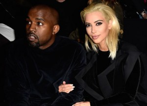 PARIS, FRANCE - MARCH 05: Kim Kardashian and Kanye West attend the Balmain show as part of the Paris Fashion Week Womenswear Fall/Winter 2015/2016 on March 5, 2015 in Paris, France.
