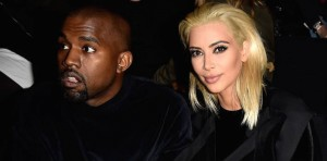 PARIS, FRANCE - MARCH 05: Kim Kardashian and Kanye West attend the Balmain show as part of the Paris Fashion Week Womenswear Fall/Winter 2015/2016 on March 5, 2015 in Paris, France. (