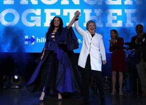 PHILADELPHIA, PA - NOVEMBER 05: Democratic presidential nominee former Secretary of State Hillary Clinton (R) raises her arms with recording artist Katy Perry (L) during a get-out-the-vote concert at the Mann Center for the Performing Arts on November 5, 2016 in Philadelphia, Pennsylvania. With three days to go until election day, Hillary Clinton is campaigning in Florida and Pennsylvania.