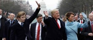 WASHINGTON, DC - JANUARY 20: U.S. President Donald Trump waves to supporters as he walks the parade route with first lady Melania Trump and son Barron Trump after being sworn in at the 58th Presidential Inauguration January 20, 2017 in Washington, D.C. Donald J. Trump was sworn in today as the 45th president of the United States