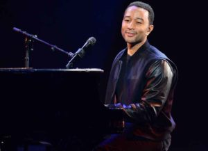 LAS VEGAS, NV - JANUARY 07: Recording artist John Legend performs during a keynote address by Yahoo! President and CEO Marissa Mayer at the 2014 International CES at The Las Vegas Hotel & Casino on January 7, 2014 in Las Vegas, Nevada. CES, the world's largest annual consumer technology trade show, runs through January 10 and is expected to feature 3,200 exhibitors showing off their latest products and services to about 150,000 attendees. (Photo: Getty)
