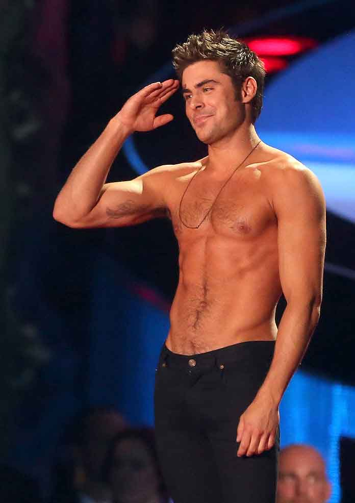 Zac Efron Shirtless At MTV Movie Awards (2014)