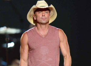 LAS VEGAS, NV - APRIL 07: Singer Kenny Chesney performs onstage during the 48th Annual Academy of Country Music Awards at the MGM Grand Garden Arena on April 7, 2013 in Las Vegas, Nevada. (Photo by Ethan Miller/Getty Images)
