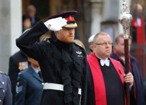 His Royal Highness Prince Harry lays a Cross of Remembrance in front of wooden crosses from the Graves of Unknown British Soldiers from the First and Second World Wars. (Image: Getty)