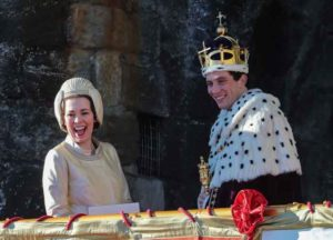 Olivia Colman, Josh O'Connor and Tobias Menzies film a scene for the Netflix drama at Caernarfon Castle. The Queen presents the newly invested Prince of Wales to the Welsh people from Queen Eleanor's Gate.