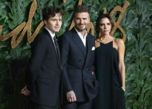 David Beckham, Victoria Beckham, and Brooklyn Beckham attend The British Fashion Awards 2018 held at the Royal Albert Hall
