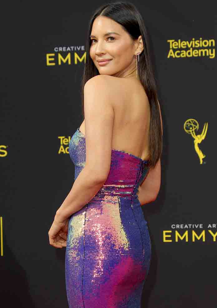 Olivia Munn Dazzles In Purple Dress At Creative Arts Emmys