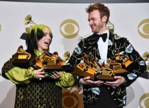 """LOS ANGELES, CALIFORNIA - JANUARY 26: (L-R) Billie Eilish, winner of Record of the Year for """"Bad Guy"""", Album of the Year for """"when we all fall asleep, where do we go?"""", Song of the Year for """"Bad Guy"""", Best New Artist and Best Pop Vocal Album for """"when we all fall asleep, where do we go?"""", and Finneas O'Connell, winner of Best Engineered Album Non-Classical for """"when we all fall asleep, where do we go?"""", Song of the Year for """"Bad Guy"""", and Producer Of The Year Non-Classical pose in the press room during the 62nd Annual GRAMMY Awards at STAPLES Center on January 26, 2020 in Los Angeles, California. (Photo: Getty)"""