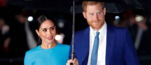 Prince Harry Holds Umbrella For Wife Meghan Markle At Endeavour Fund Awards (Image: Getty)