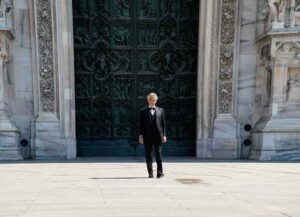 MILAN, ITALY - APRIL 12: Andrea Bocelli outside the Duomo Cathedral of Milan, before the start of the concert. On Easter day, the icon of Italian music in the world will perform alone to give a message of love during the coronavirus period. during the Andrea Bocelli Concert In Milan at the Duomo on April 12, 2020 in Milan Italy