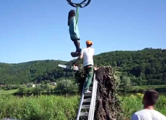 WATCH: Statue Of Melania Trump Removed After Being Set On Fire In Slovenia