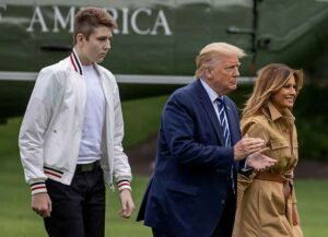 WASHINGTON, DC - AUGUST 16: Barron Trump, US President Donald Trump and First lady Melania Trump walk on the South Lawn of the White House on August 16, 2020 in Washington, DC. Robert Trump, 71, the younger brother of the president, died Saturday in Manhattan