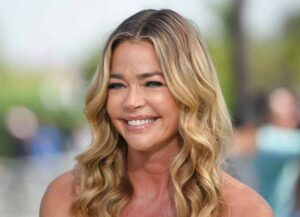 """UNIVERSAL CITY, CA - AUGUST 13: Denise Richards visits """"Extra"""" at Universal Studios Hollywood on August 13, 2018 in Universal City, California"""