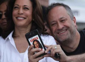 DES MOINES, IOWA - AUGUST 10: Douglas Emhoff, husband of Democratic presidential candidate U.S. Sen. Kamala Harris (D-CA), takes a selfie prior to her delivering a campaign speech at the Des Moines Register Political Soapbox at the Iowa State Fair on August 10, 2019 in Des Moines, Iowa. 22 of the 23 politicians seeking the Democratic Party presidential nomination will be visiting the fair this week, six months ahead of the all-important Iowa caucuses.