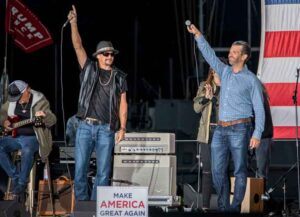 HARRISON, MICHIGAN - SEPTEMBER 14: Kid Rock (L) and Donald Trump Jr. speak onstage during the Trump 2020 rally on September 14, 2020 in Harrison, Michigan.