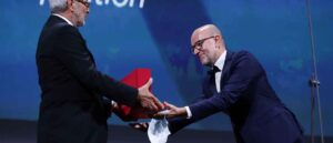 "VENICE, ITALY - SEPTEMBER 12: Davide Romani (R) receives the Golden Lion for Best Film on behalf of US director Chloe Zhao for ""Nomadland"" from President of the Venice Biennale Roberto Cicutto (L) during the closing ceremony at the 77th Venice Film Festival on September 12, 2020 in Venice, Italy."