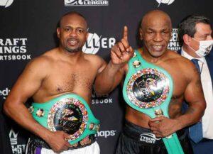 LOS ANGELES, CALIFORNIA - NOVEMBER 28: Roy Jones Jr. (L) and Mike Tyson celebrate their split draw during Mike Tyson vs Roy Jones Jr. presented by Triller at Staples Center on November 28, 2020 in Los Angeles, California.