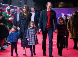 LONDON, ENGLAND - DECEMBER 11: Prince William, Duke of Cambridge and Catherine, Duchess of Cambridge with their children, Prince Louis, Princess Charlotte and Prince George, attend a special pantomime performance at London's Palladium Theatre, hosted by The National Lottery, to thank key workers and their families for their efforts throughout the pandemic on December 11, 2020 in London, England.