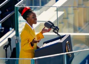 WASHINGTON, DC - JANUARY 20: Youth Poet Laureate Amanda Gorman speaks at the inauguration of U.S. President Joe Biden on the West Front of the U.S. Capitol on January 20, 2021 in Washington, DC. During today's inauguration ceremony Joe Biden becomes the 46th president of the United States. (Photo by Drew Angerer/Getty Images)