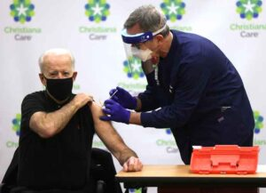 WILMINGTON, DELAWARE - JANUARY 11: President-elect Joe Biden (L) receives the second dose of a COVID-19 Vaccination from Chief Nurse Executive Ric Cuming (R) at ChristianaCare Christiana Hospital on January 11, 2021 in Newark, Delaware. Biden received the second dose of the Pfizer/BioNTech coronavirus vaccine, three weeks after the first dose he had received a few days before Christmas in 2020.. (Photo by Alex Wong/Getty Images)