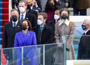 WASHINGTON, DC - JANUARY 20: Doug Emhoff (from left), Vice President Elect Kamala Harris, Cole Emhoff, Ella Emhoff, and Vice President Mike Pence stand as Lady Gaga sings the National Anthem at the inauguration of U.S. President-elect Joe Biden on the West Front of the U.S. Capitol on January 20, 2021 in Washington, DC. During today's inauguration ceremony Joe Biden becomes the 46th president of the United States. (Photo by Win McNamee/Getty Images)