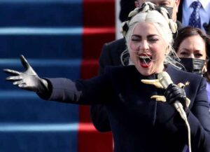WASHINGTON, DC - JANUARY 20: Lady Gaga sings the National Anthem during the inauguration of U.S. President-elect Joe Biden on the West Front of the U.S. Capitol on January 20, 2021 in Washington, DC. During today's inauguration ceremony Joe Biden becomes the 46th president of the United States. (Photo by Rob Carr/Getty Images)