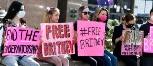 LOS ANGELES, CALIFORNIA - FEBRUARY 11: Supporters hold signs at the hearing for the Britney Spears Conservatorship at Stanley Mosk Courthouse on February 11, 2021 in Los Angeles, California. (Photo by Frazer Harrison/Getty Images)