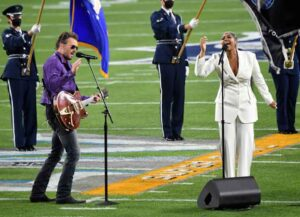 TAMPA, FLORIDA - FEBRUARY 07: (L-R) Eric Church and Jazmine Sullivan perform during the Super Bowl LV Pregame at Raymond James Stadium on February 07, 2021 in Tampa, Florida. (Photo by Kevin Mazur/Getty Images for TW)