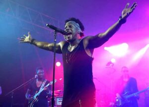 MANCHESTER, TN - JUNE 13: D'Angelo performs during day 3 of the Bonnaroo Music & Arts Festival on June 13, 2015 in Manchester, Tennessee. (Photo by Gary Miller/Getty Images)