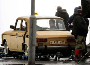 GLASGOW, SCOTLAND - JANUARY 28: Actor Taron Egerton on set at the filming of The Tetris on January 28, 2021 in Glasgow, Scotland. Streets in the city have been transformed into 1980s Russia during the filming of the Soviet-themed movie Tetris. (Photo by Jeff J Mitchell/Getty Images)