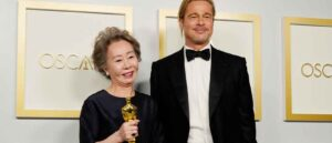 "LOS ANGELES, CALIFORNIA - APRIL 25: (L-R) Yuh-Jung Youn, winner of Best Actress in a Supporting Role for ""Minari,"" poses with Brad Pitt in the press room at the Oscars on Sunday, April 25, 2021, at Union Station in Los Angeles. (Photo by Chris Pizzello-Pool/Getty Images)"
