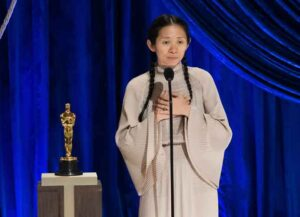 LOS ANGELES, CALIFORNIA – APRIL 25: (EDITORIAL USE ONLY) In this handout photo provided by A.M.P.A.S., Chloé Zhao accepts the Directing award for 'Nomadland' onstage during the 93rd Annual Academy Awards at Union Station on April 25, 2021 in Los Angeles, California. (Photo by Todd Wawrychuk/A.M.P.A.S. via Getty Images)