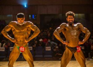 SRINAGAR, KASHMIR, INDIA - APRIL 04: Amid the pandemic bodybuilders strike a pose during the Mr. Srinagar Bodybuilding Competition organized by Jammu and Kashmir Bodybuilding Association, on April 04, 2021 in Srinagar, the summer capital of Indian administered Kashmir, India. At a time when India is in the grip of the second wave of Coronavirus pandemic (COVID-19), Srinagar's many top bodybuilders took part in an event, health experts have again urged people to follow Covid guidelines. The championship was canceled last year but organizers went ahead with the event this year amid the pandemic. Kashmiri youths are taking interest in bodybuilding, making it a popular sport in Kashmir. Bodybuilders said sports can help ease the psychological trauma of decades-old conflict in Kashmir Many major sporting events across the world have either been postponed or canceled. As many as 93,249 more people tested positive for Covid-19 in the last 24 hours as the second wave of the infection rages across the country said the Union health ministry on Sunday. With more than 11.35 million recoveries since the beginning of the pandemic and 165,132 total deaths have been recorded. (Photo by Yawar Nazir/Getty Images)
