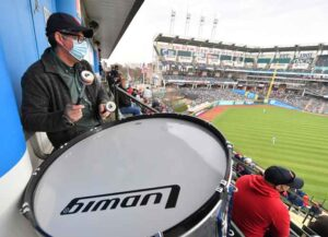 CLEVELAND, OHIO - APRIL 05: Patrick Carney, drummer for the rock duo Black Keys, stands in for Cleveland Indians legendary drummer John Adams during the fourth inning of the home opener against the Kansas City Royals at Progressive Field on April 05, 2021 in Cleveland, Ohio. (Photo by Jason Miller/Getty Images)