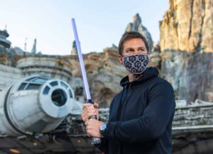 LAKE BUENA VISTA, FL - APRIL 5: In this handout photo provided by Walt Disney Resorts, NFL superstar Tom Brady visits Star Wars: Galaxy's Edge inside Disney's Hollywood Studios at Walt Disney World Resort on April 5, 2021 in Lake Buena Vista, Florida. Brady spent time in a galaxy far, far away to celebrate the Tampa Bay Buccaneers victory in Super Bowl LV this past February, where the star quarterback was named MVP. (Photo by Matt Stroshane/Walt Disney World Resorts via Getty Images)