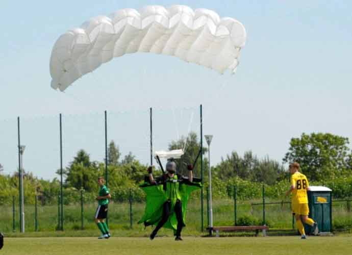 Referee Gives Skydiver Yellow Card For Landing In Middle Of Game