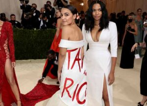 NEW YORK, NEW YORK - SEPTEMBER 13: Alexandria Ocasio-Cortez and Aurora James attend The 2021 Met Gala Celebrating In America: A Lexicon Of Fashion at Metropolitan Museum of Art on September 13, 2021 in New York City. (Photo by Dimitrios Kambouris/Getty Images for The Met Museum/Vogue )