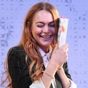 Lindsay Lohan Denies Reports She's Dating Tom Cruise