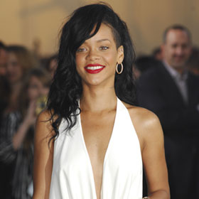 Rihanna Takes A Bow In White At Los Angeles Premiere Of 'Battleship'