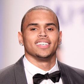 Chris Brown Denies New Tattoo Is Of Rihanna